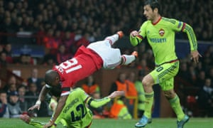 Ashley Young goes flying over Georgi Shchennikov of CSKA Moscow.