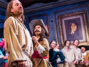 Frantically switching hats … Lee Mack, left, and cast in Molière's The Miser.