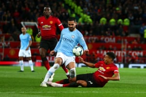 Ilkay Gundogan of Manchester City is caught by Manchester United's Jesse Lingard .