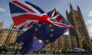 A union flag and EU flag outside the Houses of Parliament
