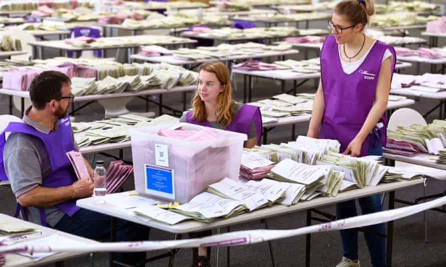Australian Election Commission staff count votes after voters cast their ballots in the federal election on Saturday.