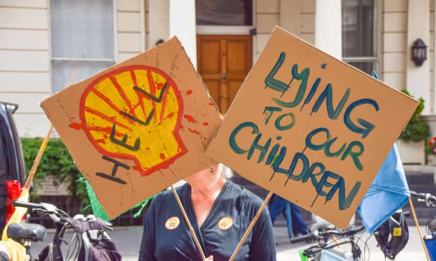 A demonstrator holds anti-Shell placards outside the Science Museum in London in July.