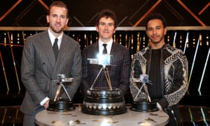 Geraint Thomas (centre) poses after winning the BBC Sports Personality of the Year award alongside third placed Harry Kane (left) and second placed Lewis Hamilton