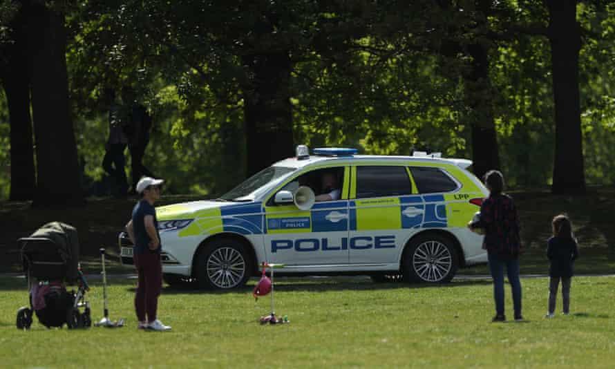 Police patrol in Greenwich Park, London, last weekend, to enforce the lockdown.
