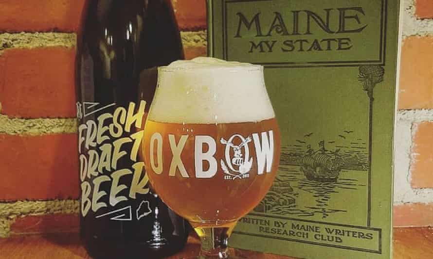 Bottle of beer and a full glass of beer from Oxbow Brewing Company, Portland, Maine.