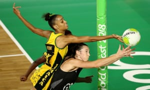 New Zealand's Bailey Mes stretches for the ball under pressure from Shamera Sterling of Jamaica.