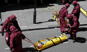 Member of the emergency services tend to a 'casualty' during Exercise Strong Tower in central London.