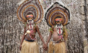 Two pre-adolescent boys who are dressed for yam spirit ritual from Abelam tribe in Papua New Guinea. Taken in Maprik District, East Sepik, Momase Region, Papua New Guinea.