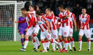 Milan Pavkov celebrates with teammates after scoring his second goal.