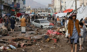 Residents pick their way through a damaged street in the capital Sana'a, Yemen on 14 April