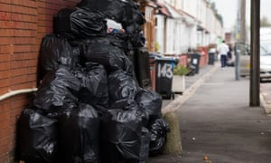 Rubbish bags piled up in front of bins in Moseley Road, Birmingham
