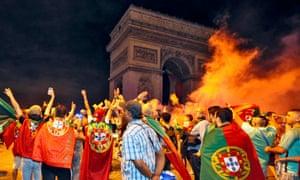 Portugal fans celebrate winning Euro 2016 at the Arc de Triomphe in Paris.