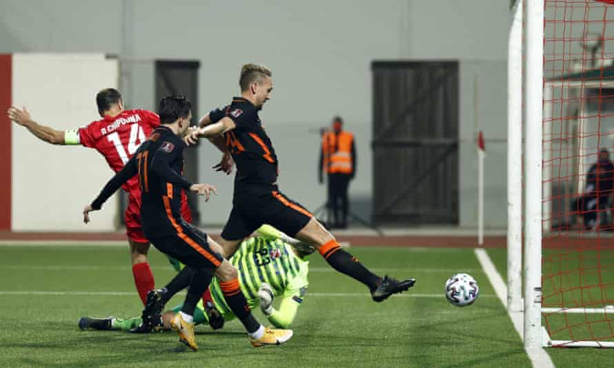 Luuk de Jong stretches to score the second goal for the Netherlands from close range in the 7-0 win over Gibraltar