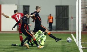Luuk de Jong of The Netherlands sticks out a leg to score their second goal.