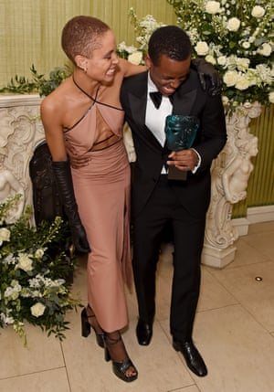 Adwoa Aboah and Micheal Ward share a laugh at the British Vogue and Tiffany & Co. Fashion and Film Party at Annabel's