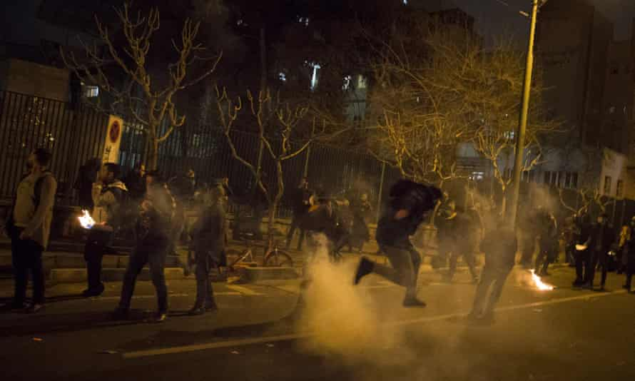 Iranians students protest in the street at night