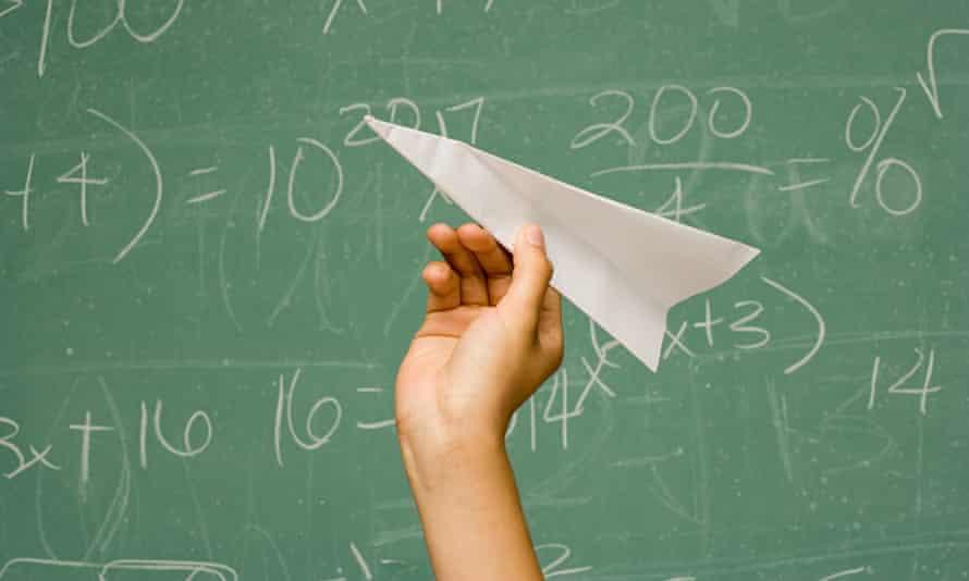 A paper aeroplane and a blackboard