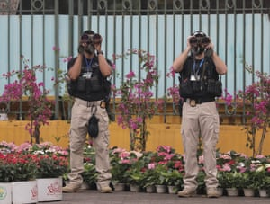 US security personnel scan the area outside the presidential palace in Hanoi