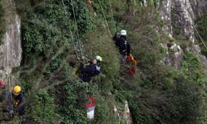 Avon and Somerset police officers abseil during the search for Charlotte Bevan and her daughter.