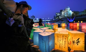 People float candle-lit paper lanterns on the Motoyasugawa river on the 70th anniversary of the Hiroshima atomic bomb on 6 August 2015 in Hiroshima, Japan.