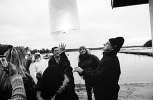 Locals and guests release a lantern on the shores of Nagu.