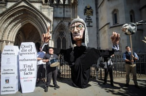 Opponents of the liberalisation of euthanasia laws demonstrate outside the Royal Courts of Justice