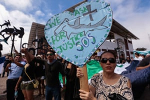 Galapagos Islands residents hold a demonstration outside the court where the crew of the Chinese-flagged ship confiscated by the Ecuadorean Navy is attending a hearing. The vessel had been carrying some 300 tons of fish, including several endangered species such as the hammerhead shark