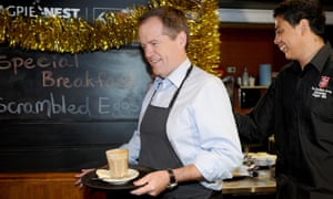Bill Shorten chats with staff and diners as he serves up a coffee, at the Salvation Army Cafe in Melbourne last week.