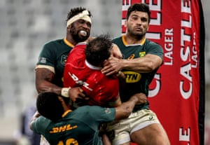 British & Irish Lions' Robbie Henshaw is tackled over the try line by Lukhanyo Am, Siya Kolisi (left) and Damian de Allende of South Africa.