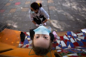 Rosi helps her daughter Vera, 10, put on her rollerskates in Santa Cruz de Tenerife