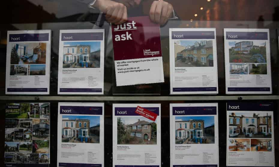 An estate agent's window in London: mortgage approvals in March slumped by almost 21%