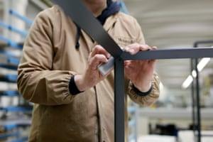 Hand sanding a frame.