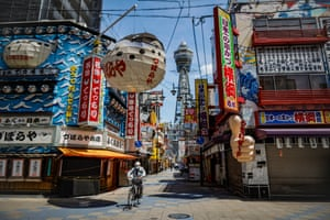 The almost deserted main street in the Shinsekai neighbourhood of Osaka, Japan