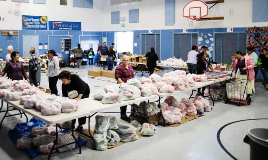 Volunteers with Second Harvest Food Bank hand out supplies at a school in Menlo Park, California.