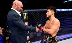 Henry Cejudo shakes hands with UFC president Dana White after announcing his retirement over the weekend.