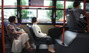 A statue of a teenage girl pictured on a bus running through downtown Seoul.
