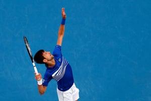 Djokovic serves to start the match.