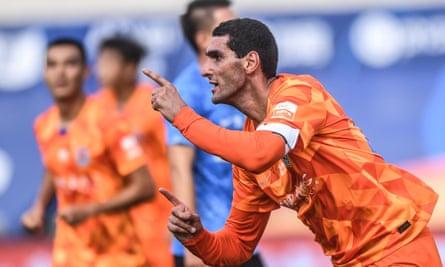 Shandong Luneng's Marouane Fellaini celebrates after scoring one of three headers against Dalian Pro on Sunday.