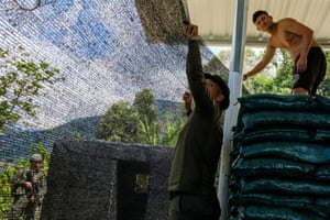 Members of the police's rural special operations group (GOER) fortify their new base at Monteredonda, Miranda, Cauca. The base was established in the wake of the peace accord in a coca and marijuana growing region inhabited by Nasa and campesinos and previously dominated by FARC rebels. Three police were killed last month in a grenade ambush.