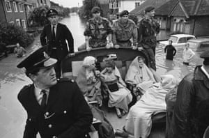 Patients from Molesey Cottage Hospital, who were rescued by police and soldiers during flooding in Surrey, 17 August 1968.