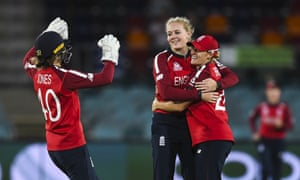 Sarah Glenn of England (centre) celebrates with teammates after claiming the wicket of Iram Javed of Pakistan.