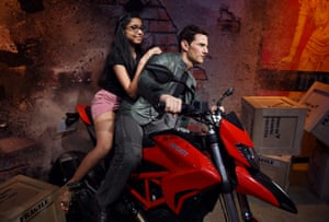New Delhi, India A visitor sits on a bike ridden by a waxwork of Tom Cruise at Madame Tussauds Delhi