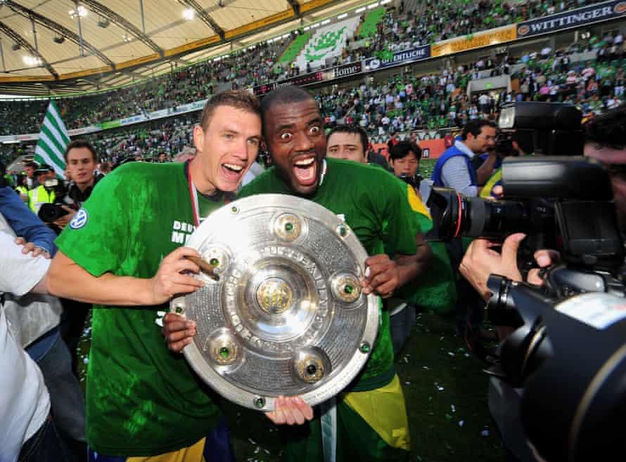 Edin Dzeko and Grafite show off the Bundesliga trophy in May 2009.