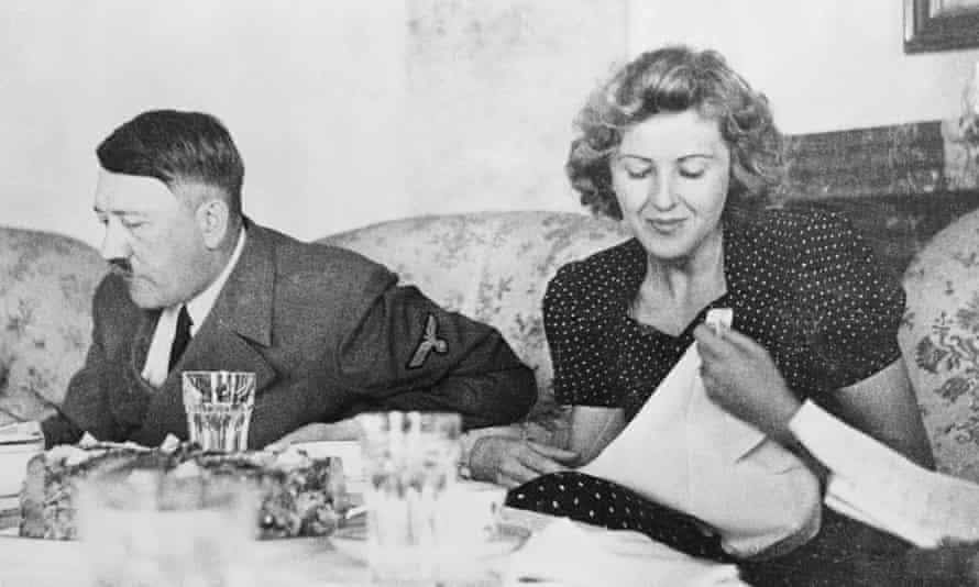 Adolf Hitler and Eva Braun dining in Berlin.