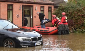 Members of the Fire and Rescue service helping a resident of Fishlake