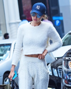 Model Gigi Hadid in a blue cap on the streets of Manhattan.