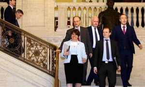 Northern Ireland's Democratic Unionist Party DUP leader, Arlene Foster, centre, with party colleagues.