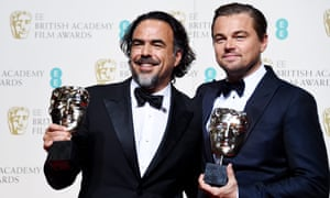 Alejandro Gonzalez Inarritu and Leonardo DiCaprio pose with their awards for best director and best actor, both for The Revenant.
