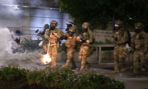 Federal officers deployed teargas and fired 'less-lethal' rounds into a crowd of protesters late on Thursday