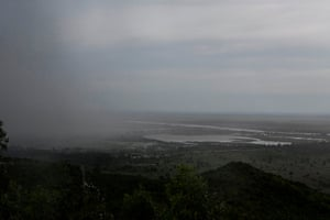 Rain falls over the flooded districts of Chikwawaa and Nsanje in southern Malawi, on 15 March.